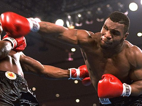Mike-Tyson-Throws-Punch-AP